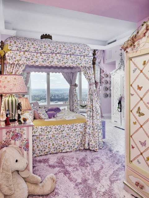Lavender girls room in a NYC penthouse with a view of the city, lavender carpeting and a canopy bed