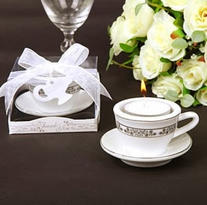 http://www.specialgiftboxes.com/product/coffee-cup-candle-favor/