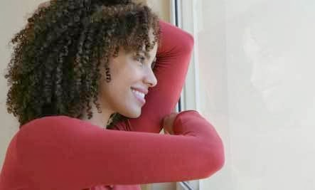 8 Love Adages to Ignore - happy woman girl looking through window