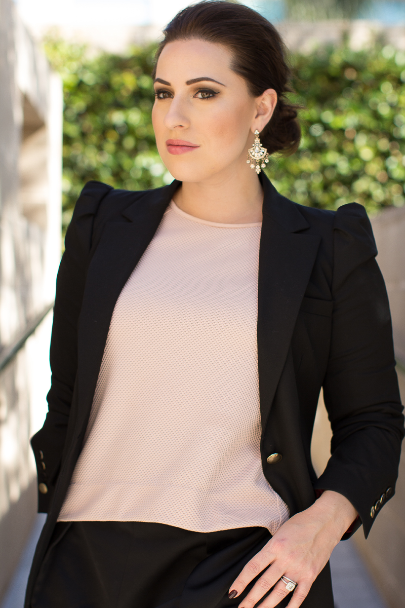 chandelier earrings, black blazer