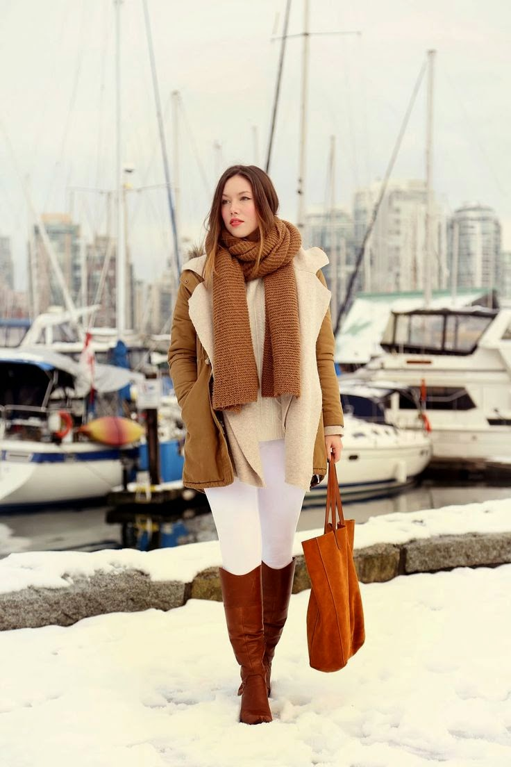 Bundle up in chic, winter whites accented by luxe tan accents and some red lipstick