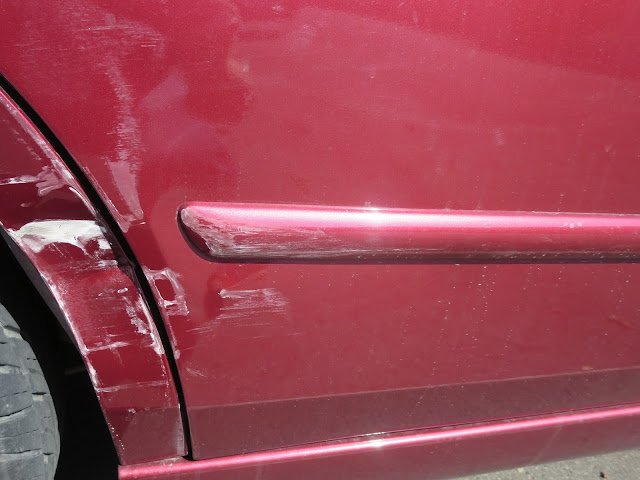Collision damage to quarter panel & door before repairs at Almost Everything Auto Body