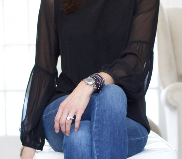 Close up of Victoria Emerson wrap bracelet, watch, ring