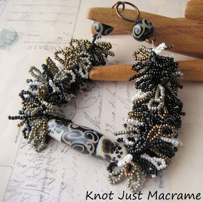 Handmade fringe bracelet by Sherri Stokey of Knot Just Macrame with Juli Cannon lampwork focal