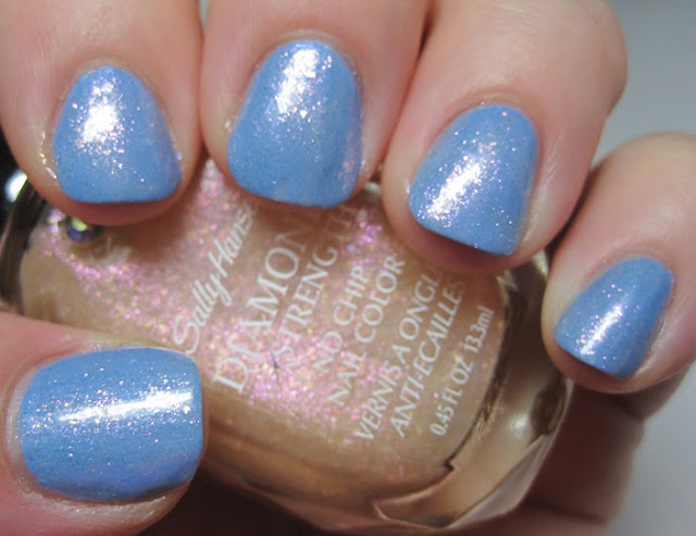 Sally Hansen Diamond Strength Gold Setting over Guess Blue?