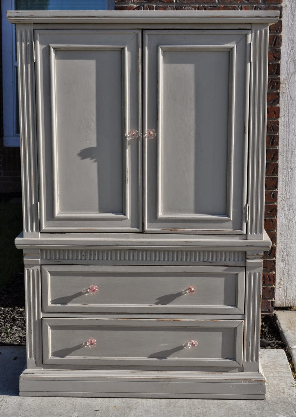 taupe armoire with pink flower. Black Bedroom Furniture Sets. Home Design Ideas