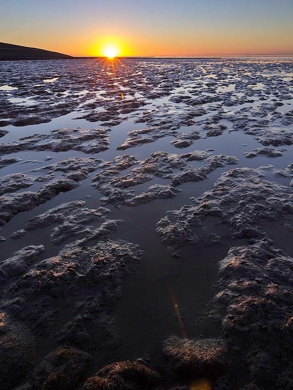 Zon zakt in de Waddenzee
