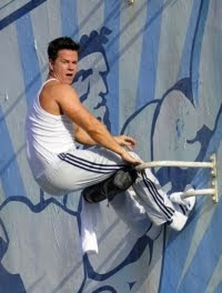 Pain and Gain - Mark Wahlberg doing some harness-enhanced wall sit-ups.