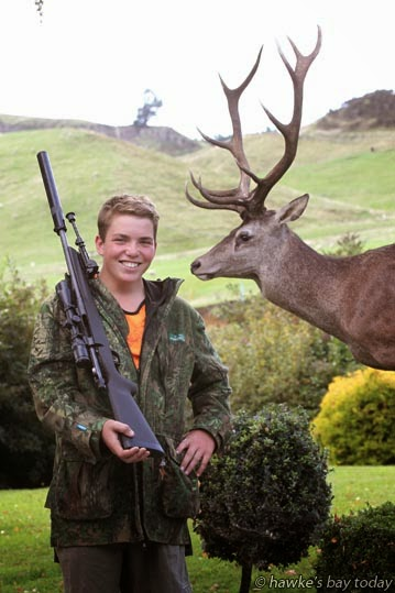 Henry Sinclair is a keen hunter, pictured on his birthday (today) with George from the Gorge, mounted for him as a birthday gift from his parents, Trish and Craig Sinclair, Kohurau Farming Company, Waiwhare, winners of the 2015 Silver Fern Farms Hawke's Bay Farmer of the Year, at the Napier Port Hawke's Bay Primary Sector Awards. photograph