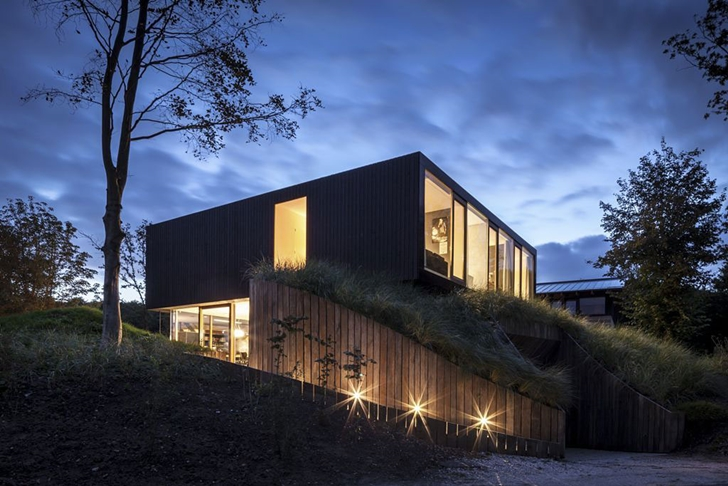 Driveway and Modern Villa V by Paul de Ruiter Architects at night