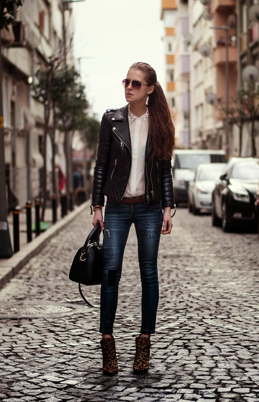 Leather jackets, white shirt, skinnies and cheetah print high heels