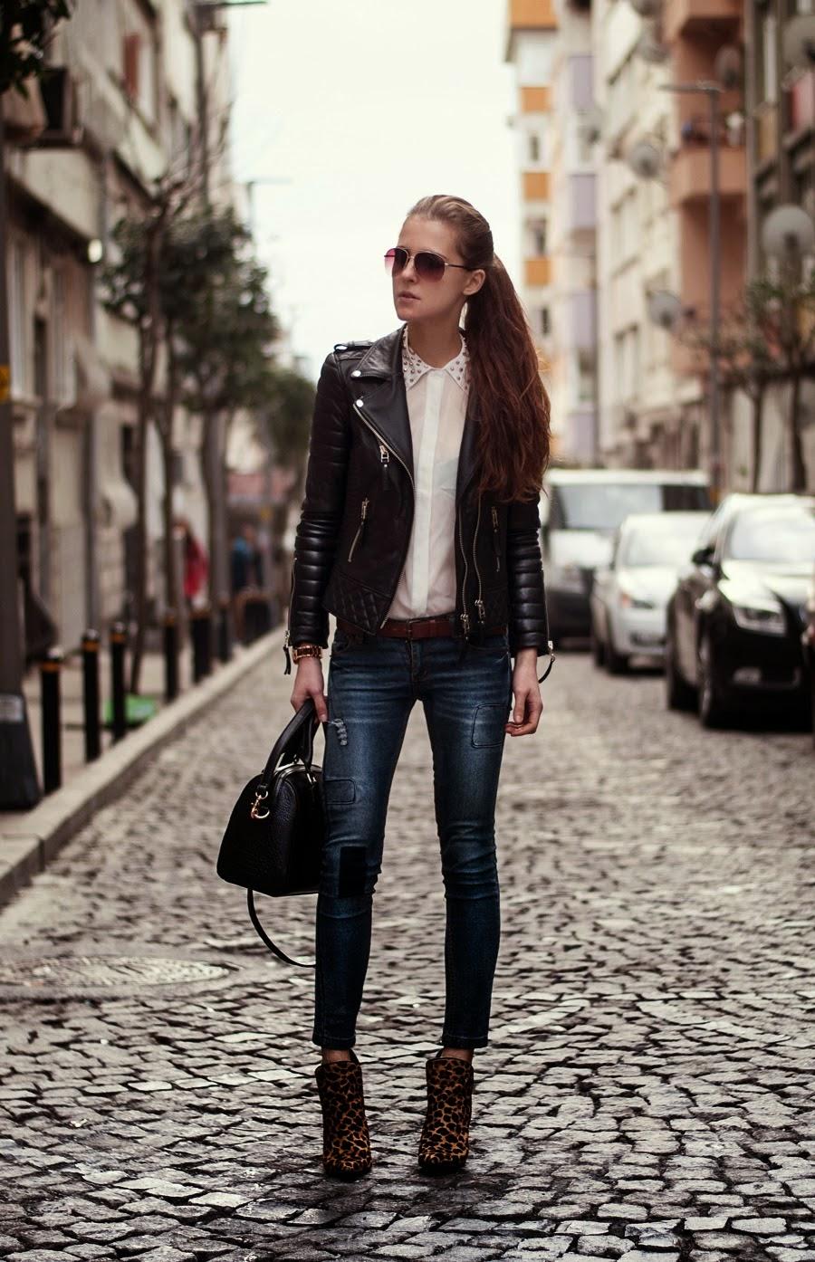Leather jackets, white shirt, skinnies and cheetah print high heels