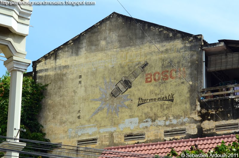 Fading hand painted sign for Bosch in Phnom Penh