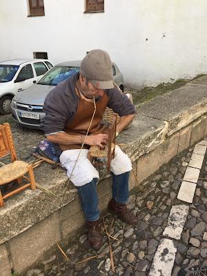 A man weaves bulrush in Ronda