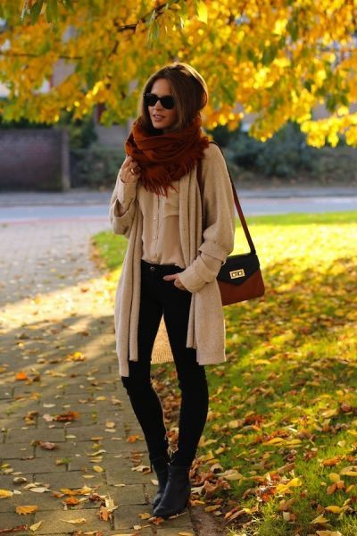 Brown scarf, cream color long jacket, black pants and hand bag for ladies