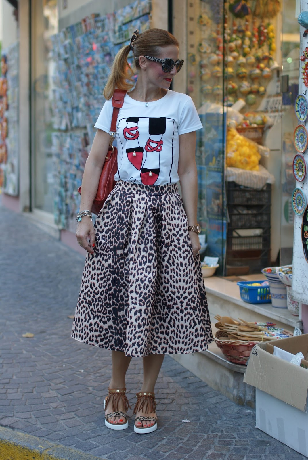 Leopard print is the new neutral with Dolce & Gabbana leopard sunglasses found on Giarre.com, leopard print midi skirt on Fashion and Cookies fashion blog, fashion blogger style