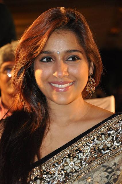 Rashmi Gautam Stills At Dhana Lakshmi Talupu Tadithe Audio Launch