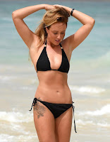 There are no mistake as Charlotte Crosby, 25, displaying the enviable curves in a black string bikini while strolling to the hotel beach of the Fancy Melia Dunas on Monday, December 17, 2015.