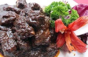 rendang tok is a very dark dry beef rendang is one of the famous