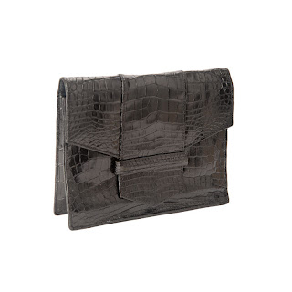 Vintage 1960's YSL dark brown aligator clutch with envelope closure.