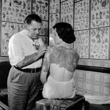 vintage woman getting tattoo via Lexi DeRock of Voluptuous Vintage Vixen