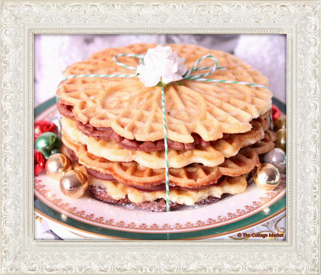 These homemade pizzelles are prepared to perfection and dusted with powdered sugar.