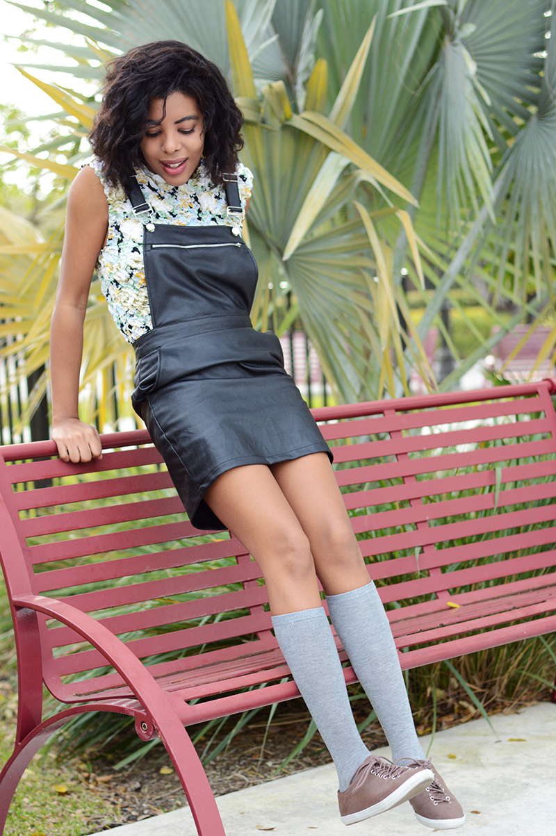 Fashion Blogger Anais Alexandre of Down to Stars in a Go Jane black leather overall dress and vintage top with cooperative sneakers
