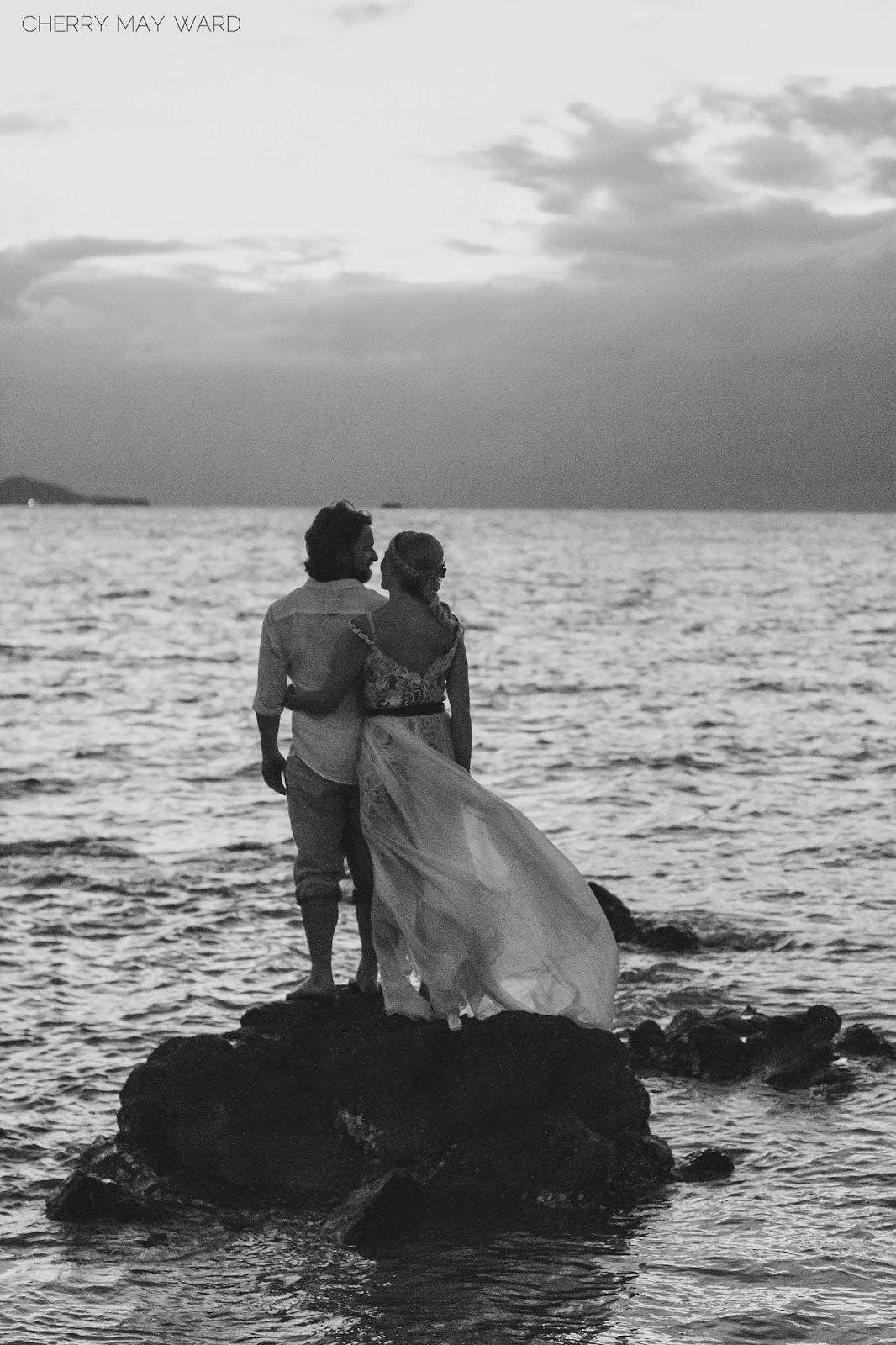 black and white wedding portraits, wedding portraits of bride and groom in the water, on the beach, beautiful photo of bride and groom standing on a rock in the sea at sunset, just married, newly weds on Koh Samui, destination wedding in Thailand, Cherry May Ward Photography