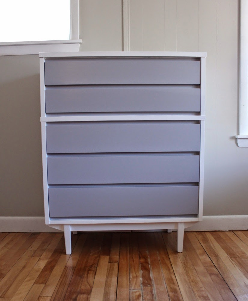 The Drawer Fronts Are Pale Gray. The Shell And Tapered Legs Are White. The  Drawers Are Constructed With Dovetail Joints. All Five Drawers Slide Well.