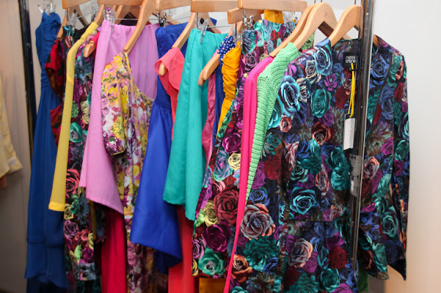 Colourful rail of clothing from Nelly
