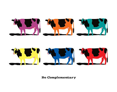 poster with multiple colored cows in complementary colors