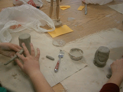Terra Cotta Warriors being built by clay coils, slabs and clay modeling
