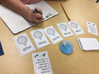 https://www.teacherspayteachers.com/Product/Roll-and-Tell-Addition-and-Subtraction-10-100-1000-Holidays-1012056
