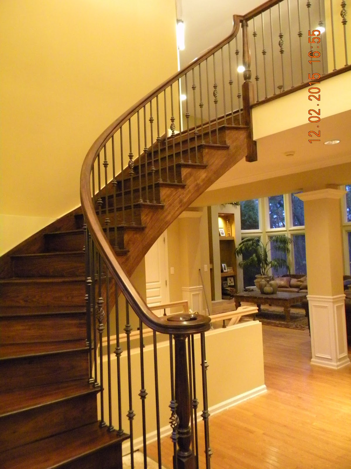 Wood stairs and rails and iron balusters custom curved for Custom stair