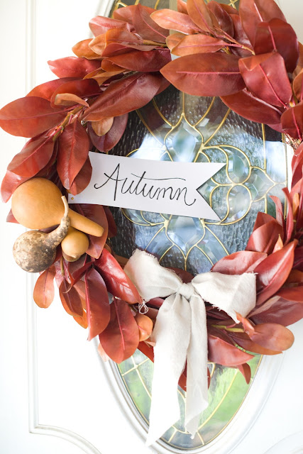 Fall magnoila wreath with dried ghords and autumn sign