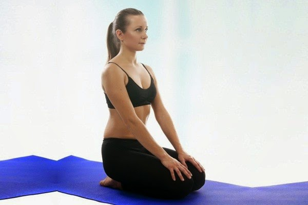 A girl performing Vajrasana