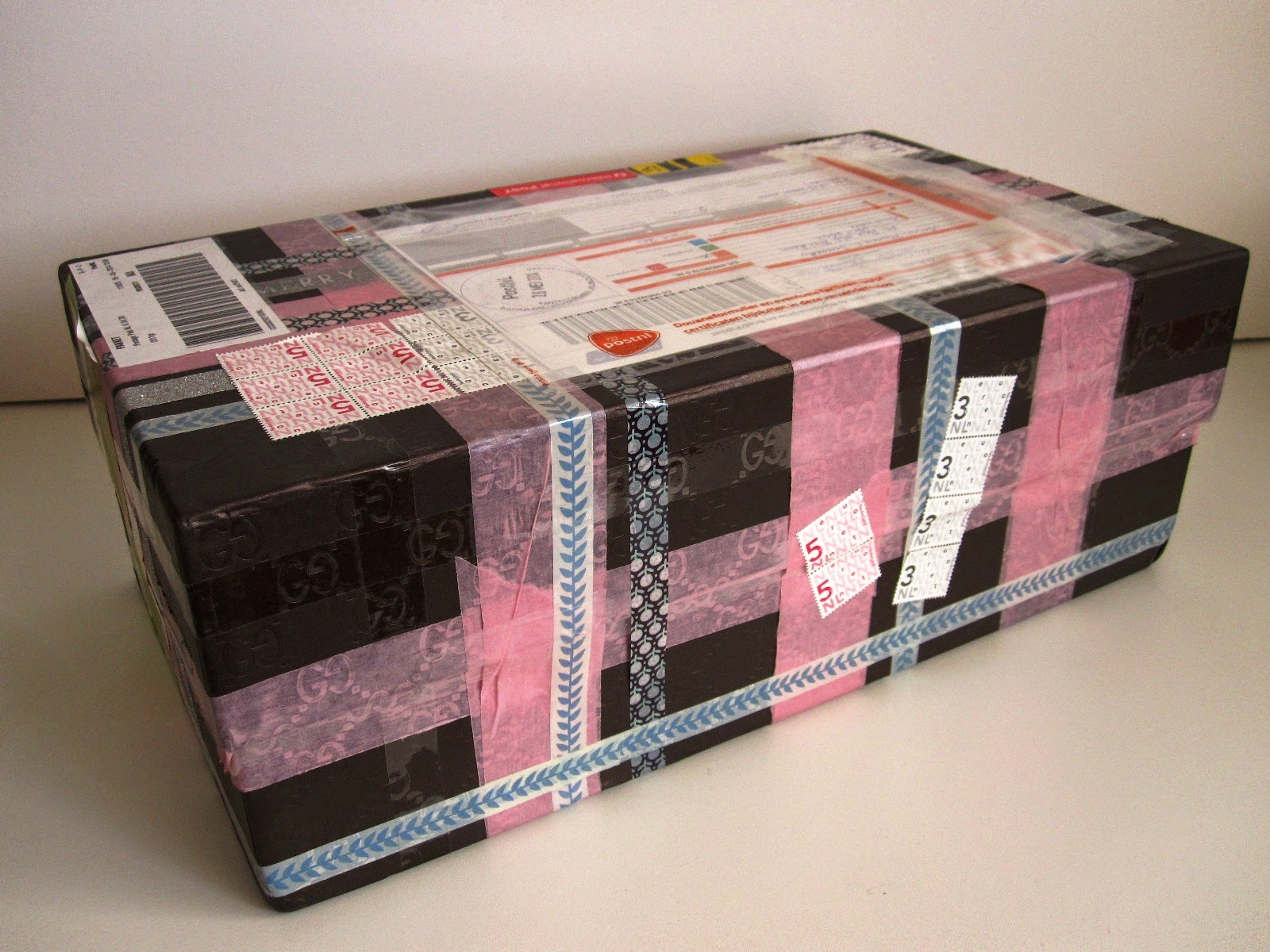 Large shoe box, wrapped with various washi tapes.There are postal sticker on the top of it.
