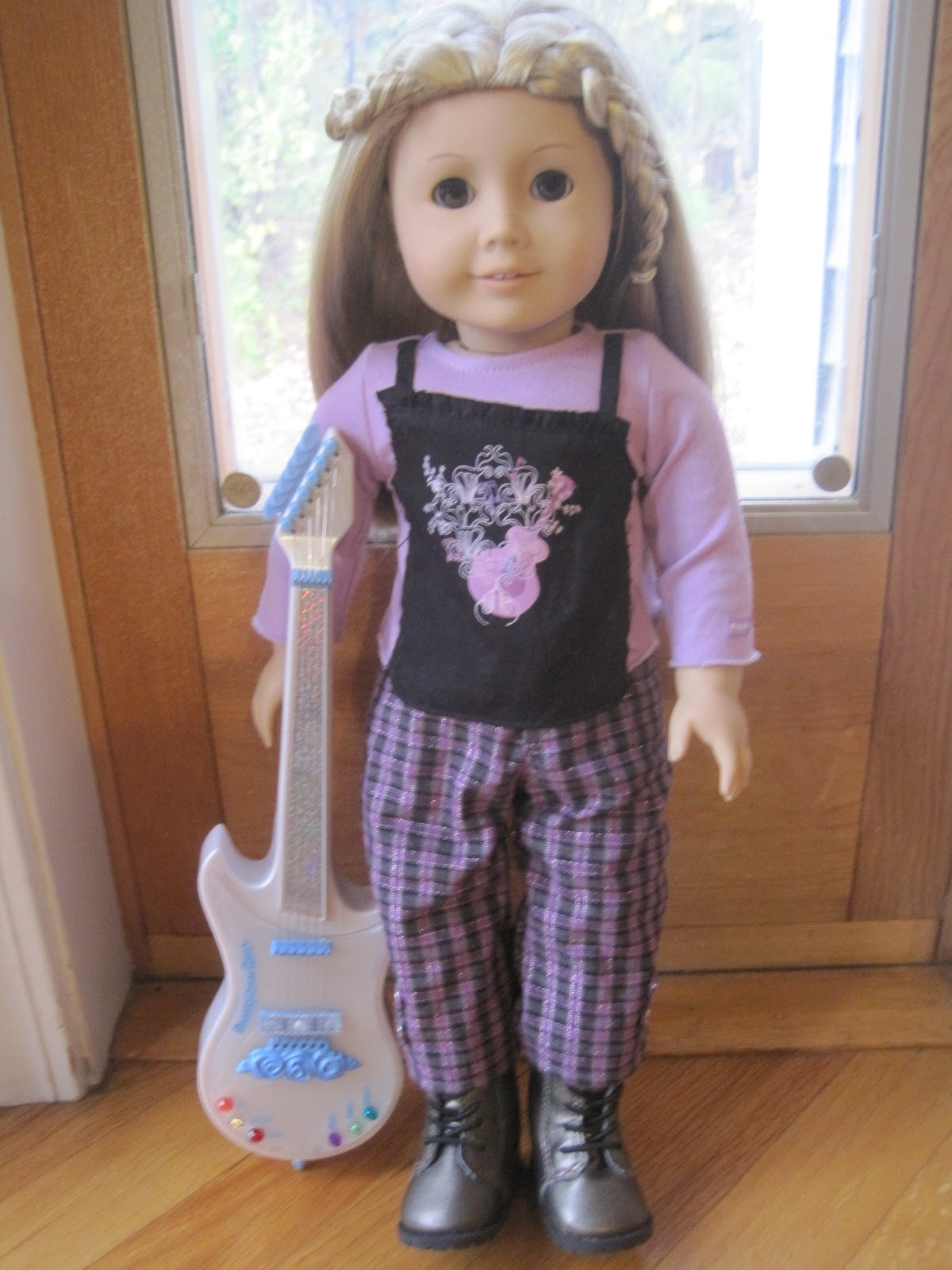 Kailey is a rock star!! Even completed with American Girlu0027s electric guitar (retired a few years ago)  sc 1 st  American Girl Dolls Forever & American Girl Dolls Forever: Our American Girl Doll Halloween Costumes!!