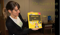 Picture of a girl holding a copy of EDM310 For Dummies