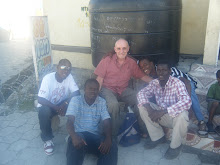 HAITI: Wayne McRann in front of the clinic, Jamaica Base, with some locals who work with HTHH
