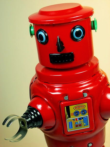 It's a little red tin toy robot.