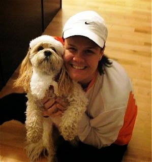 Woman smiling and holding her dog