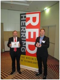 Medigoo Co-Founders CEO Mika Karilahti (lef) and COO Marko Karhiniemi are showing the Red Herring Top 100 Europe Award certificate and the award item.