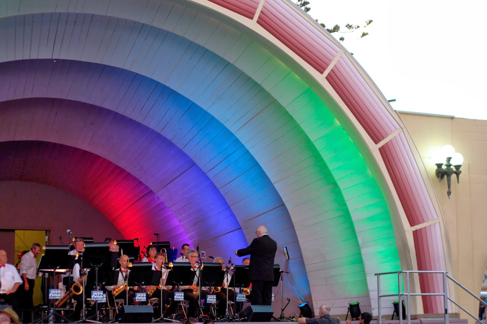 A band plays in the Napier Soundshell. It's lit up like a rainbow.