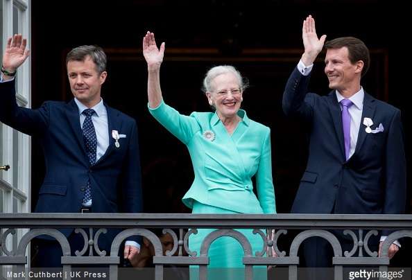 Queen Margrethe II of Denmark with Crown Prince Frederik of Denmark and Prince Joachim of Denmark on the balcony at Amalienborg Palace during festivities for the 75th birthday of Queen Margrethe II Of Denmark