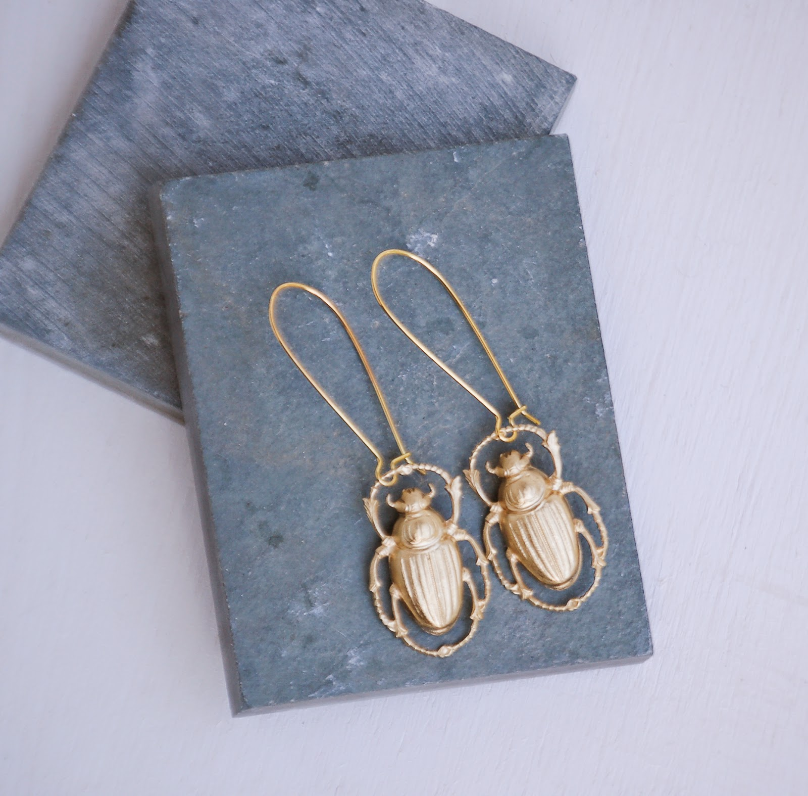 https://www.etsy.com/listing/226803713/gold-beetle-earrings-nature-study?ref=shop_home_active_2&ga_search_query=beetle