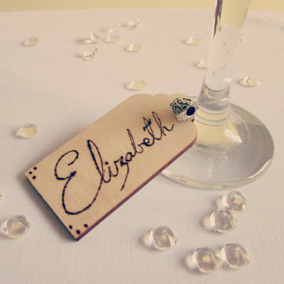 Bespoke wooden plaseholders and keepsakes for wedding. Woodburned by hand onto birchwood gift tags. Etsy. Wine glass charm.