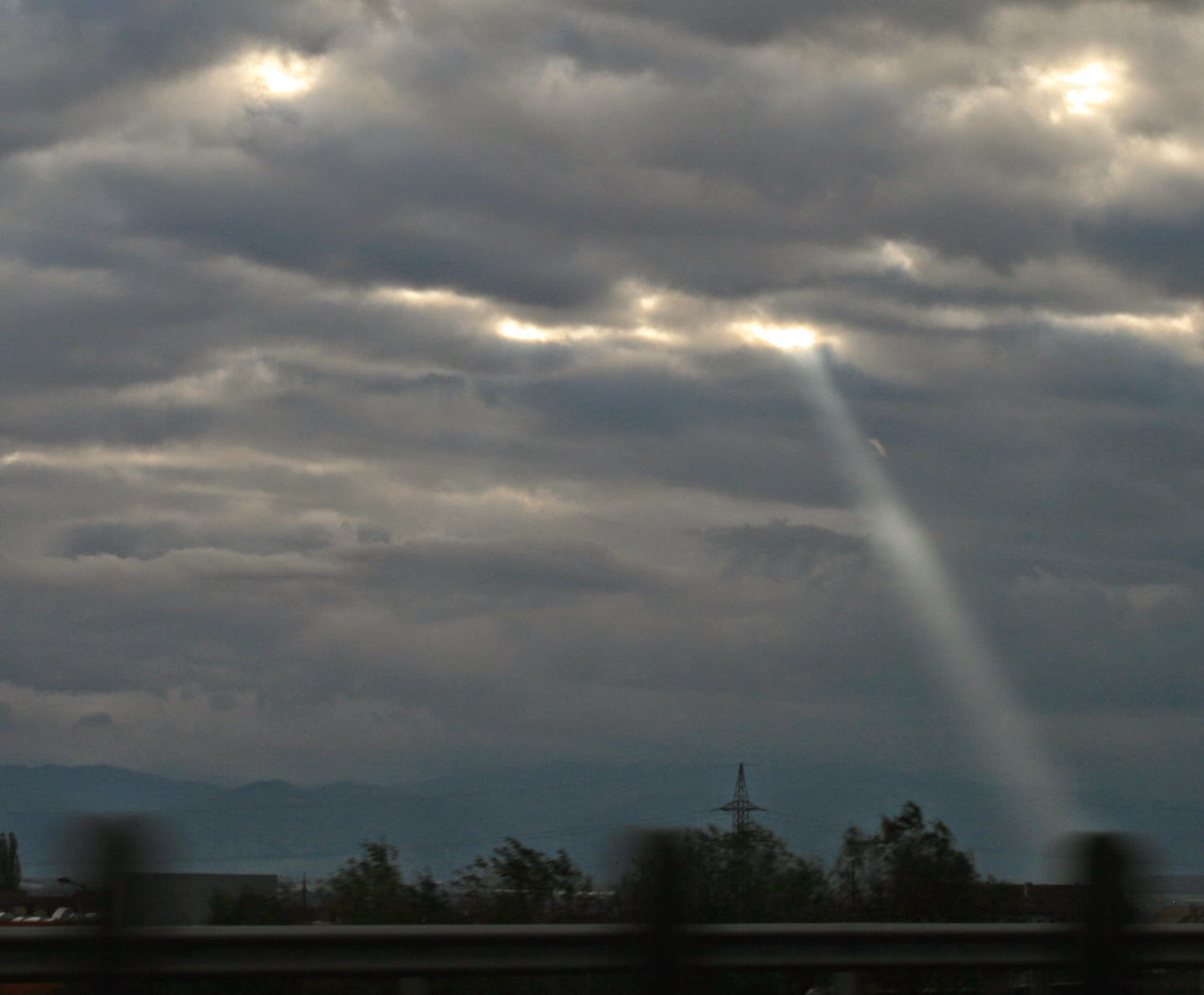 A single shaft of sunlight breaks through the clouds