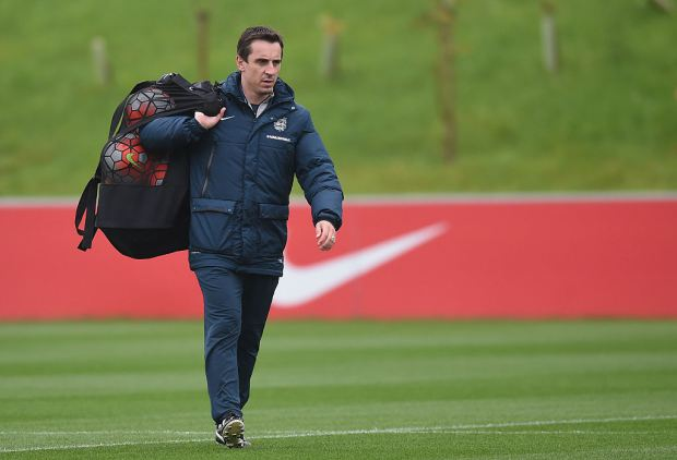 England coach Neville is also touted to be in the running (Picture: Getty Images)