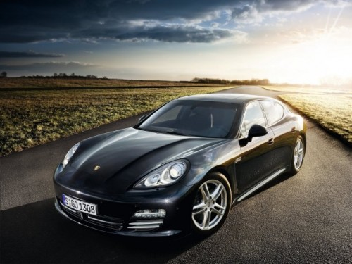 Front 3/4 view of black 2011 Porsche Panamera parked in rural setting